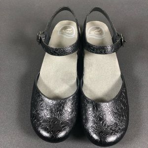 Dansko Sam Floral Tooled Shoes.